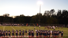 The varsity squad looks on as the offense goes for 3rd and 5
