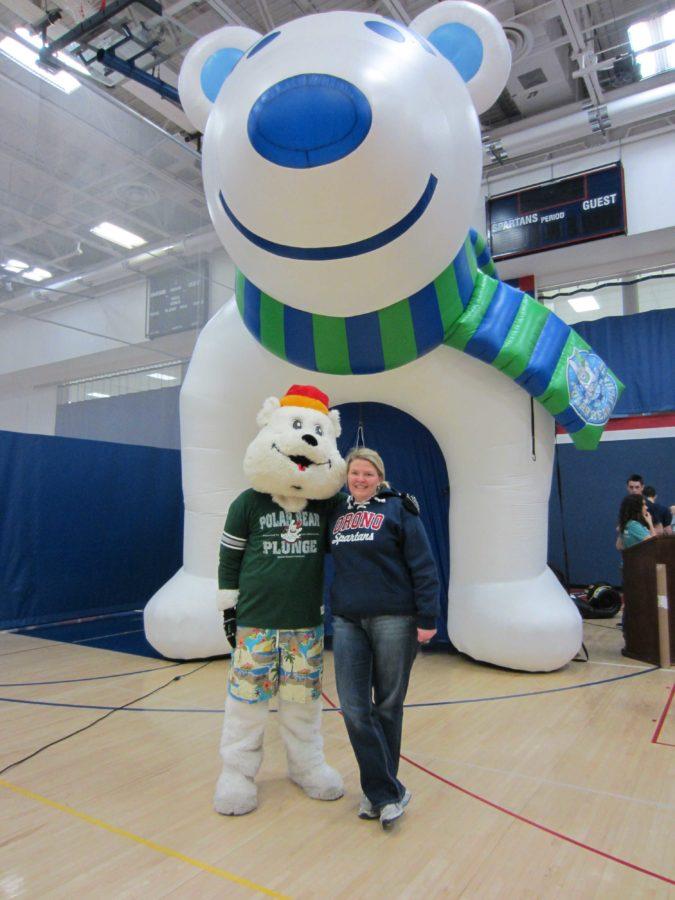 Photo/ Betty Mueller  Polar Plunge mascot Snowflake with OHS math teacher Michelle Swenson