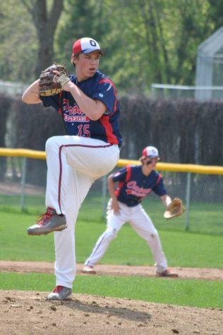 Junior Jake Hartman winds up to throw a strike