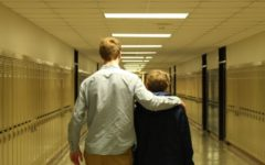 Sam Sustacek gives advice to a freshman.
