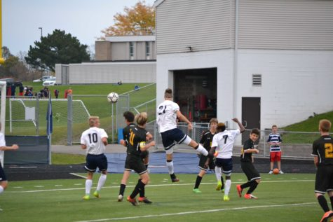 The boys soccer team work hard during the game to have success throughout the year.