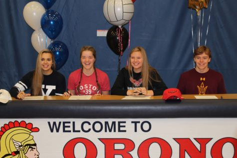 Seniors Tori Andrew, Sam Fischer, Megan Anderson, and Will Brenton pose for a picture before signing their letters