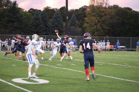 Quarterback Nick Prentice throws the ball down the field during Homecoming.