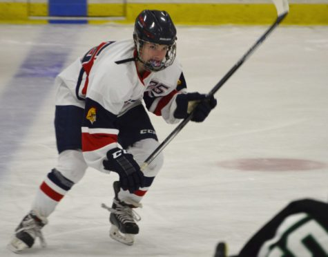 Claire Suchy playing for Orono Girl's Hockey.