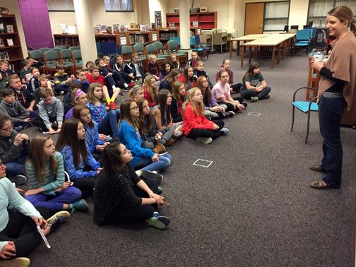 Orono alum Abby Fabiaschi talks with OMS sixth graders.