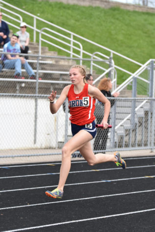 Track Star Runs Her Way To First
