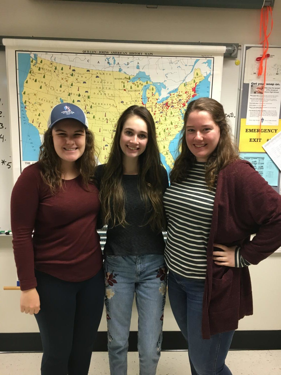 Seniors Mollie McGrann, Kelly Rash and Caroline Koehl get together to plan their future meetings on the Current Events club.