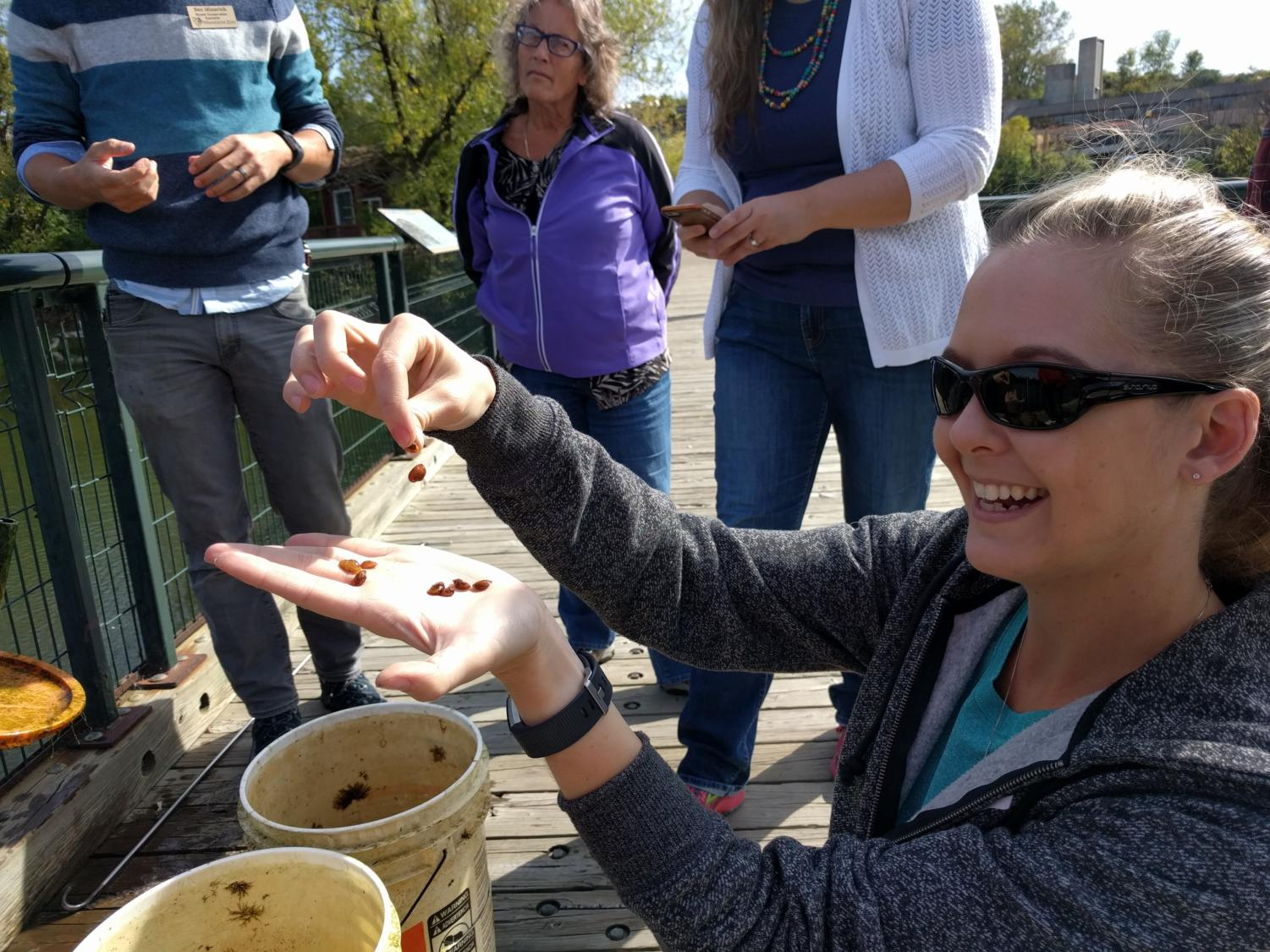 Science teacher Suzanne Kehret exhibits mussels that are friendly to the native ecosystem.