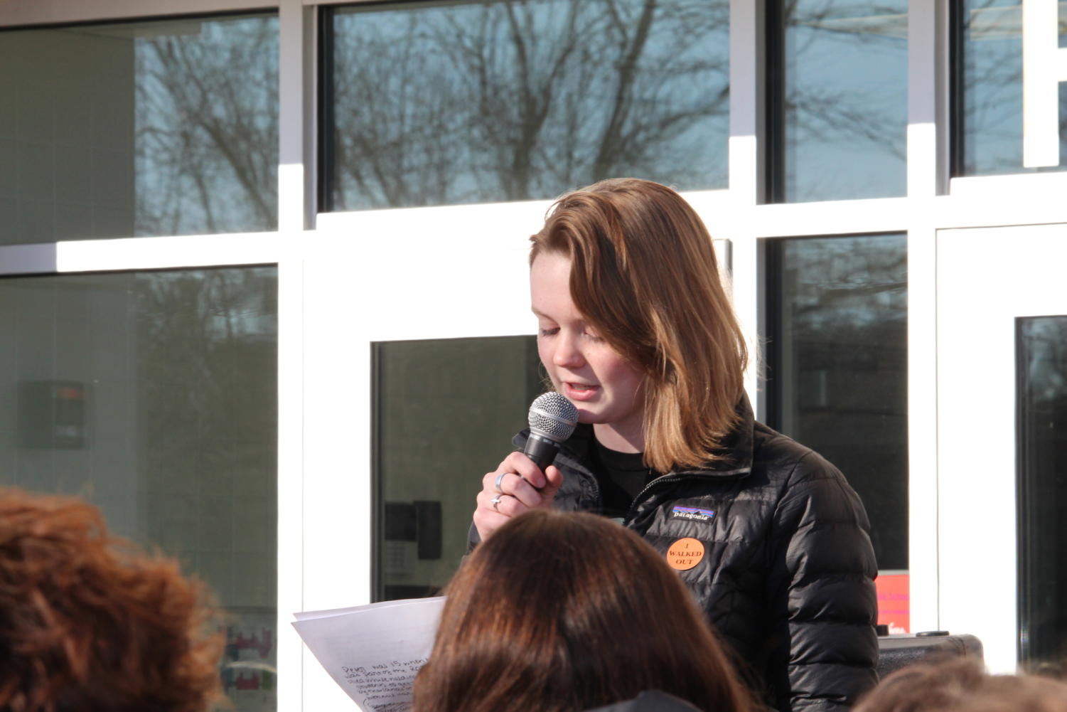 junior Carolyn Fritz reads junior Isabel Bergerson's speech at the head of the protest group