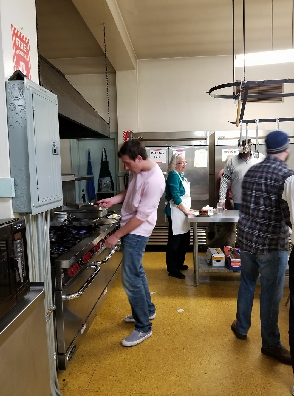 Junior Josh Kovalik prepares a meal