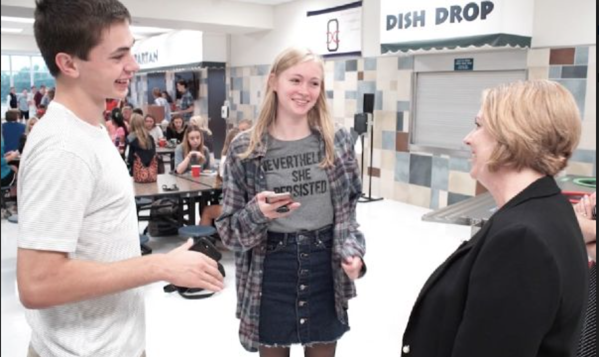 New principal at Orono high school, Dr.Steiner, meets with students at the OHS Activities Fair.