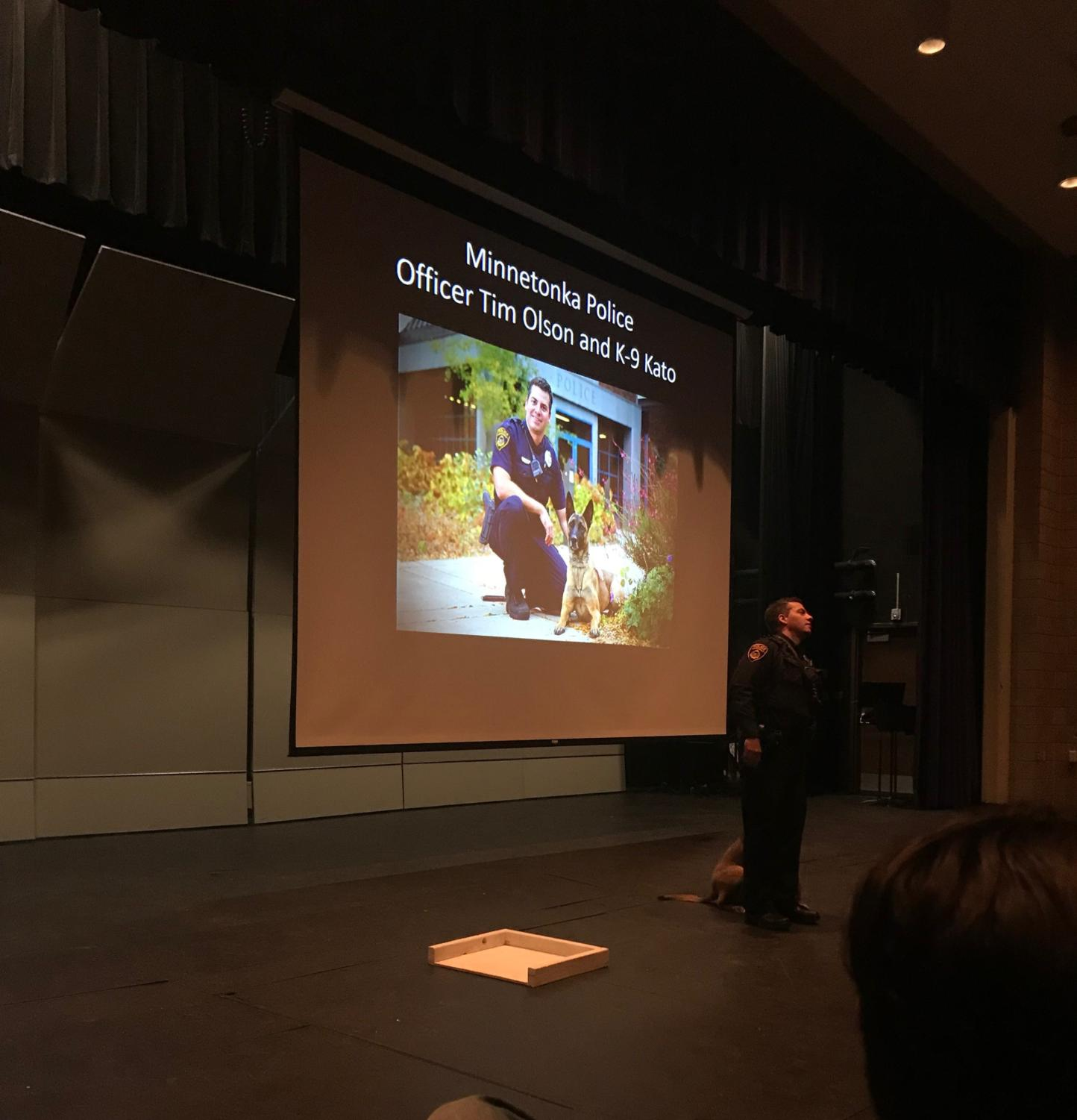 Minnetonka police officer Tim Olson shows Orono psychology students how the department uses operant conditioning to train police dogs