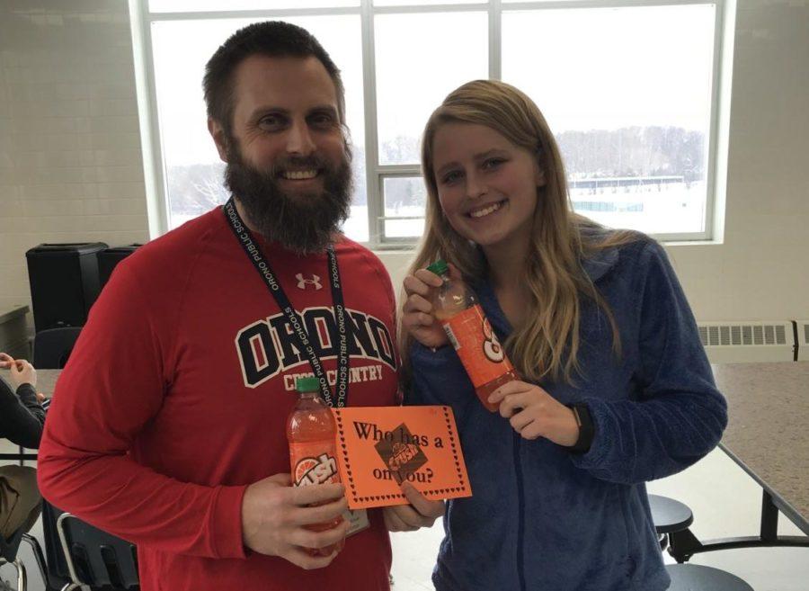 Senior Kristin Van Buren with Mr. Porter. Van Buren sent Porter an Orange Crush for Valentines Day.