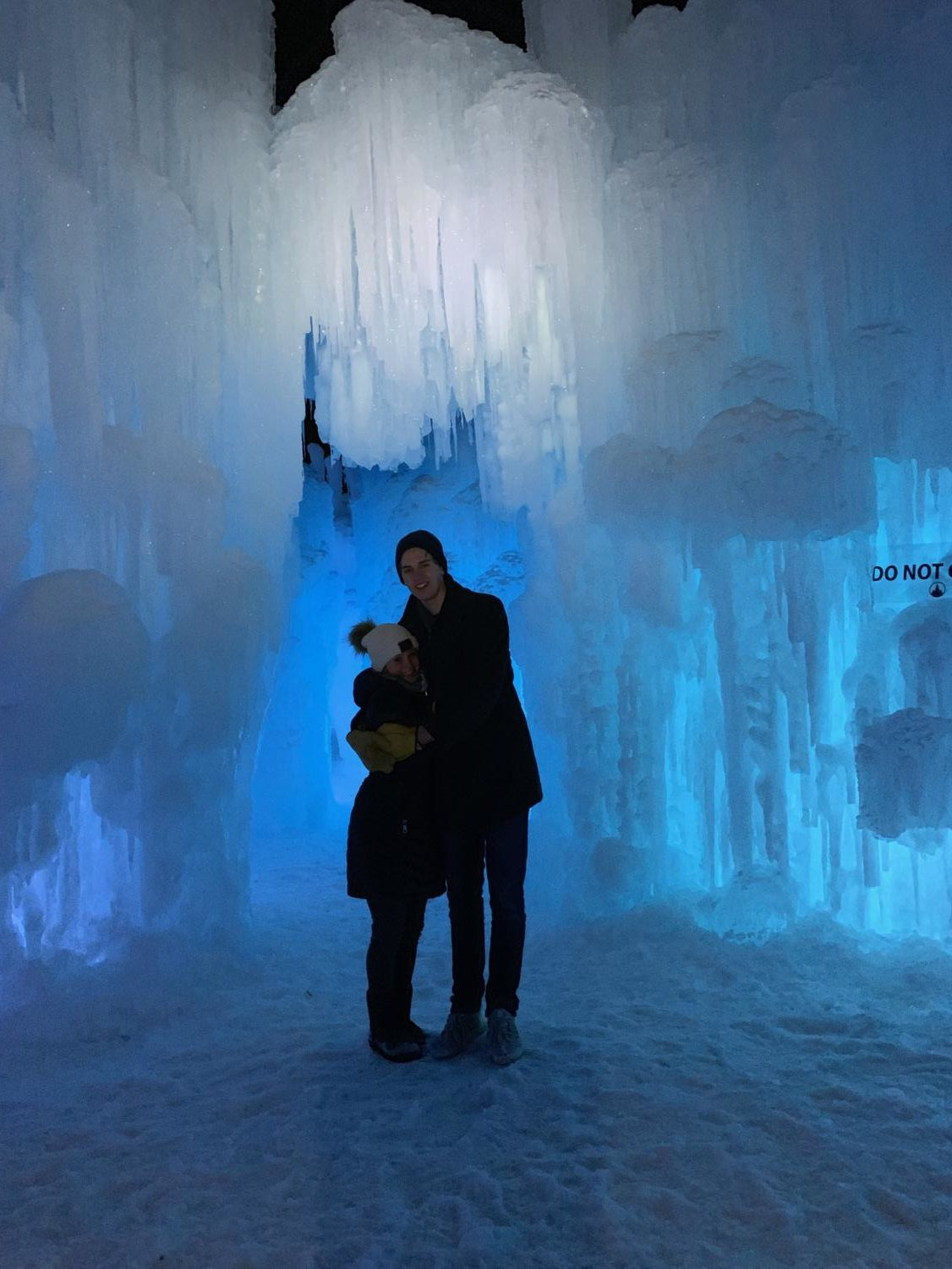 A young couple enjoys their time at the Ice Castles in Excelsior
