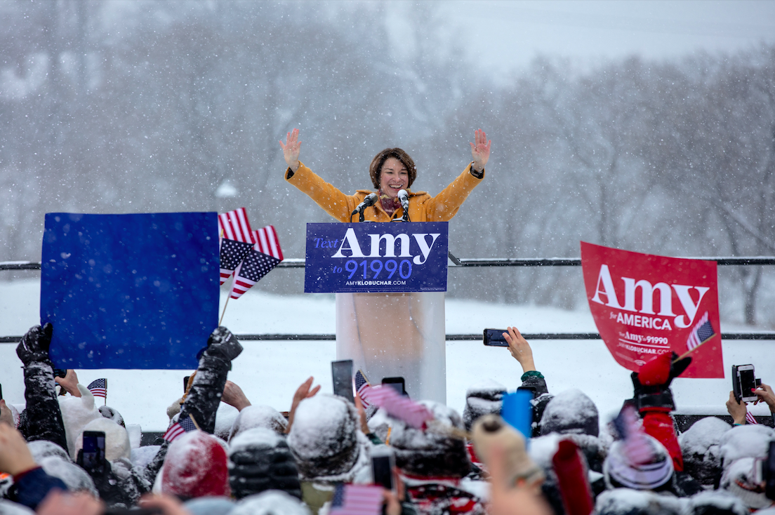 Klobuchar stands on the banks of the Mississippi announcing her campaign for the 2020 presidential election.