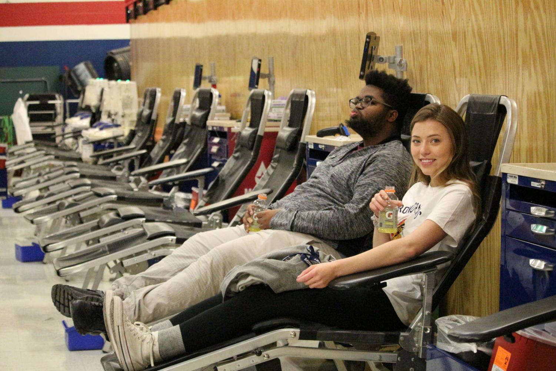 Seniors Jaylynn Buesgens and Kendall Kirk preparing to donate blood.