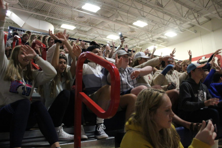 As part of fall 2019 homecoming festivities, students sway along to performers at the variety show.