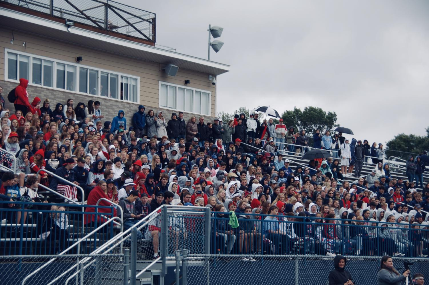 The high school student section celebrates the Pep-Fest and Parade on Friday.