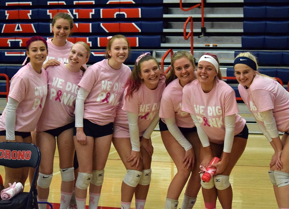 The Orono girls volleyball team at their 'Dig Pink' game.