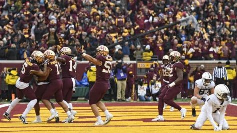 Minnesota Gophers celebrate after Jordan Howden made an incredible interception.