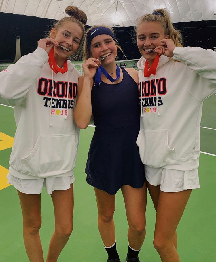 Lily Anderson with fellow teammates Carli Olsen and Taylor Gill smiling with their medals for placing in sections and making it to state.