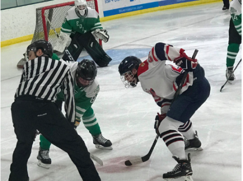 Tensions rise high as the puck is dropped in a face-off vs Edina on Dec. 18.