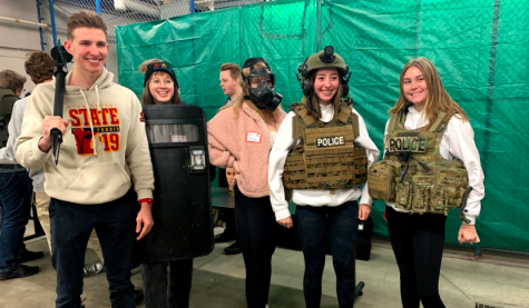 Seniors Ethan Blum, Grace Larsen, Jane Jonassen, Amelia Singleton and Audrey Link are decked out in gear on the forensics field trip.