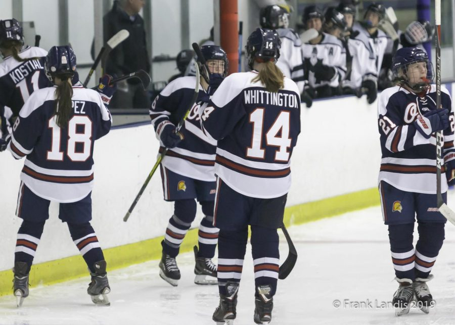 Whittington skates off the ice with her line for the next line to play.