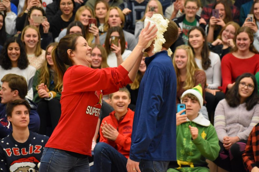 English teacher Jennifer Ivers gleefully shoves a pie into Spanish teacher (and her husband) Paul Ivers' face.