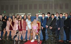 The Winterfest Court poses for the audience with newly crowned King Gus Hendrickson and Queen Grace Berbig.