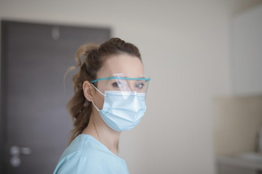 A healthcare worker wears a mask to protect from contracting the virus