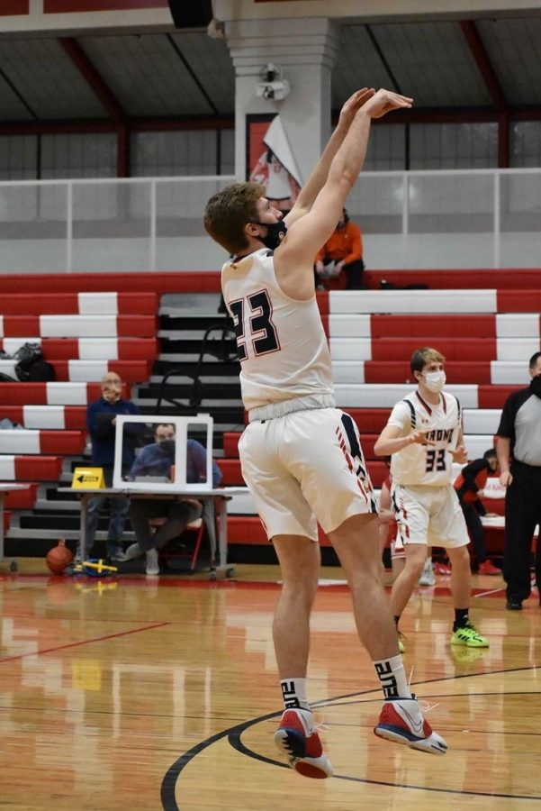 Senior athlete Connor Chappell  plays basketball during a game.