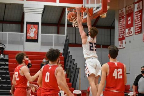 Senior Connor Chappell dunks the ball while the opposing team can only watch.