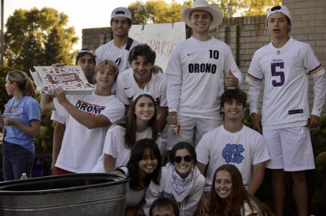 The Senior Student Body members who put together the tailgate event together pose for a picture.